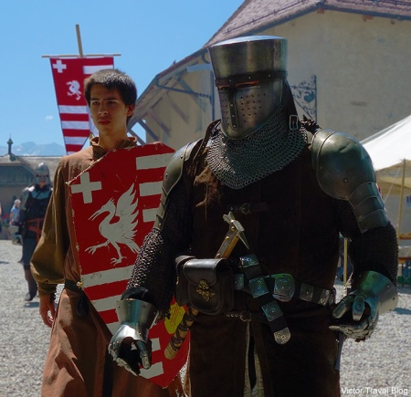 Knight with armor-bearer. Gruyeres feast. Switzerland.